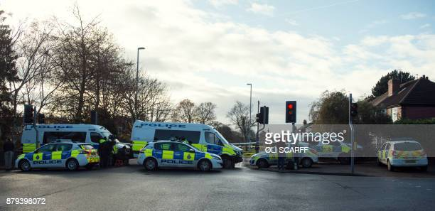 Police cars are parked at the site of a car crash in which five people including three children were killed after a stolen car crashed into a tree on...