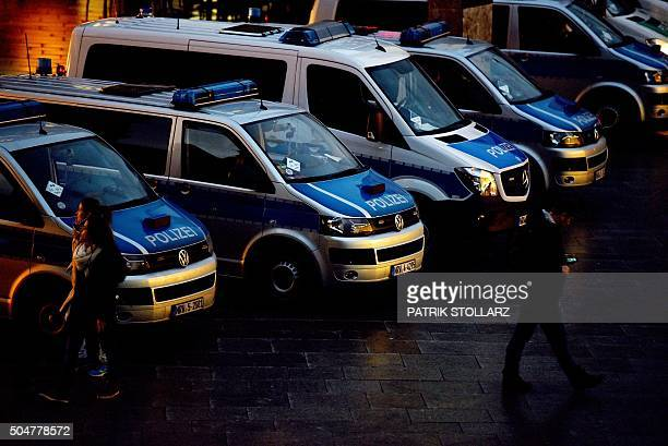 Police cars are parked next to Cologne's main train station in Cologne western Germany on January 13 2016 where dozens of apparently coordinated...