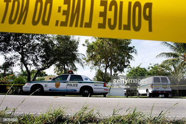 Police cars are seen in front of the home where an intruder shot Washington Redskins football player Sean Taylor in the leg November 26, 2007 in...
