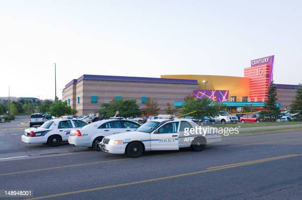 Police cars are seen in the parking area around the Century 16 movie theater in Aurora Colorado July 20 2012 where a gunman opened fire during the...