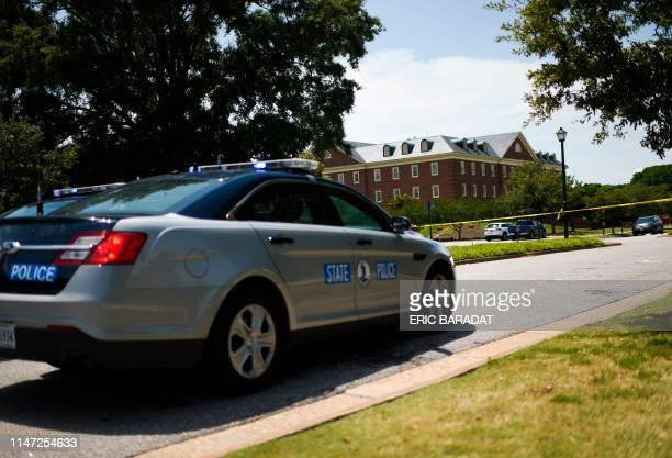 Police cars are seen near building number 2 at the Virginia Beach Municipal Center, the scene of the mass shooting, in Virginia, Beach, Virginia on...
