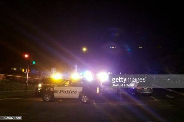 Police cars are seen outside a country music bar and dance hall in Thousand Oaks west of Los Angeles after a gunman barged into a large crowded venue...