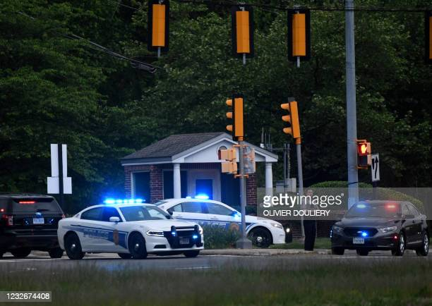 Police cars are seen outside the CIA headquarters's gate after an attempted intrusion earlier in the day in Langley, Virginia, on May 3, 2021. - An...