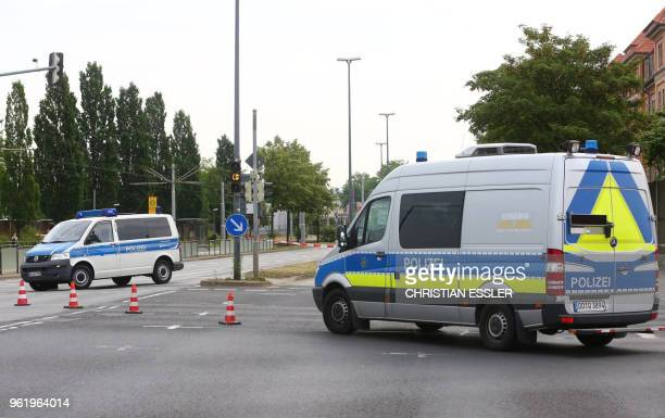 Police cars block a road on May 24 2018 to secure the area around the site in Dresden eastern Germany where a World War II bomb was found and is to...
