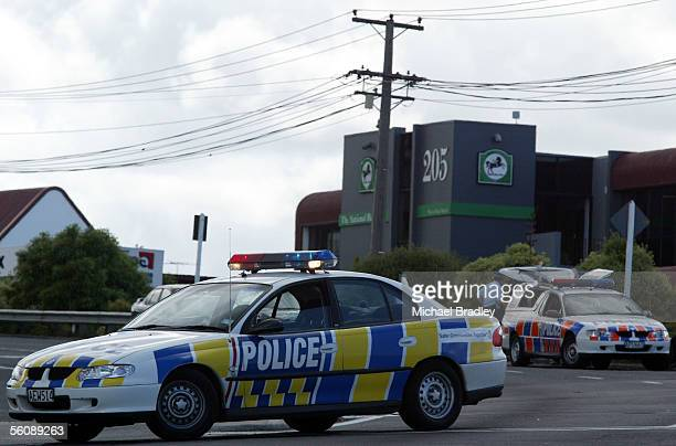 Police cars block Wairau Road after the National Bank Wairau Park Branch was held up by an armed person who also left a devise in the branch after...
