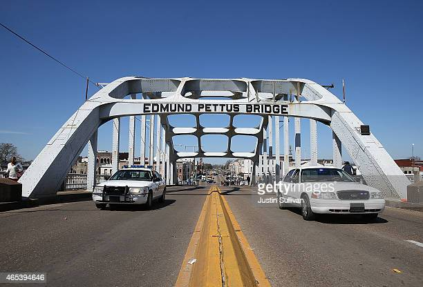 Police cars clear lanes of traffic on the Edmund Pettus Bridge on March 6 2015 in Selma Alabama Selma is preparing to commemorate the 50th...