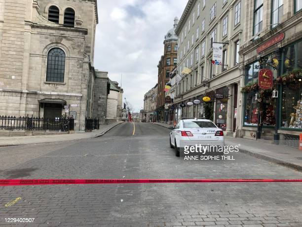 Police cars close off a street in Old Quebec, with the Quebec City Town Hall in the background on November 1, 2020 in Quebec City, Quebec. - The...