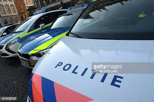 Police cars from Germany and the Netherlands stand in front of the venue of a meeting of ministers from Belgium the Netherlands and several German...