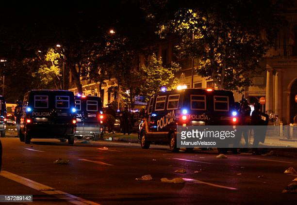 police cars in the night - riot police stock pictures, royalty-free photos & images