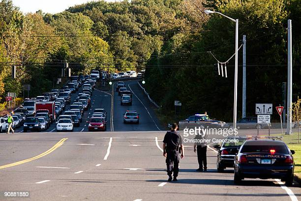 Police cars leave the parking lot of a Super 8 Motel after arresting Raymond Clark III in connection with the murder of Yale University graduate...