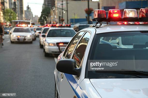 police cars on street - police car stock photos and pictures