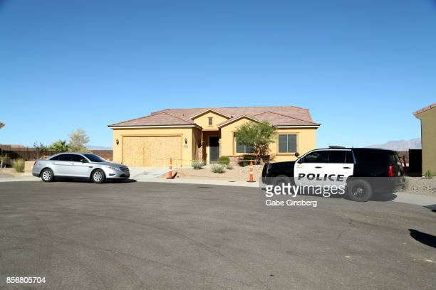 Police cars parked in front of the house in the Sun City Mesquite community where suspected Las Vegas gunman Stephen Paddock lived October 2 2017 in...