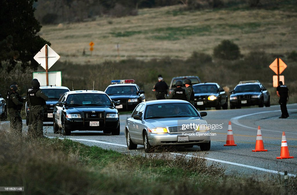 Police cars pass a blockade as they come down the mountain after a standoff with former Los Angeles Police Department officer Christopher Dorner, who is suspected of triple murder, on February 12, 2013 in Yucaipa, California. Dorner barricaded himself in a cabin near Big Bear, California and is in a standoff with authorities after shooting two police officers, killing one and wounding the other. Dorner, a former Los Angeles Police Department officer and Navy Reserve veteran, is wanted in connection with the deaths of an Irvine couple and a Riverside police officer.