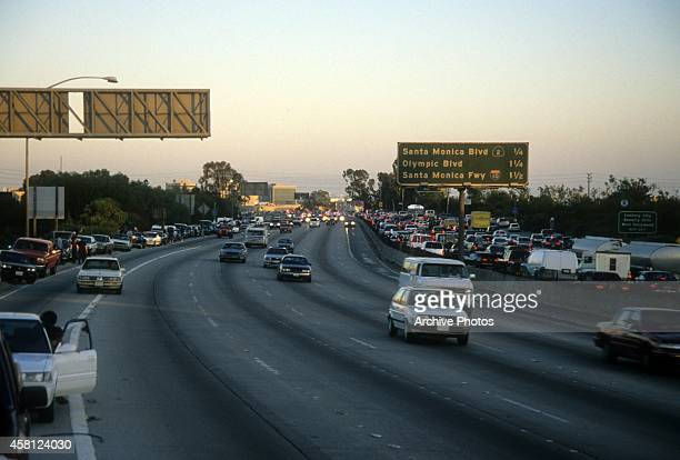 Police cars pursue the Ford Bronco driven by Al Cowlings, carrying fugitive murder suspect O.J. Simpson, on a 90-minute slow-speed car chase June 17,...