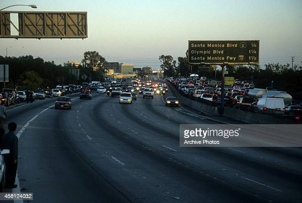 Police cars pursue the Ford Bronco driven by Al Cowlings carrying fugitive murder suspect OJ Simpson on a 90minute slowspeed car chase June 17 1994...