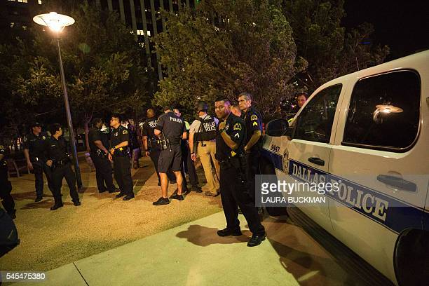 Police cars sit on Main Street in Dallas following the sniper shooting during a protest on July 7 2016 A fourth police officer was killed and two...