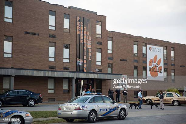 Police cars sit outside Fern Creek High School following a shooting incident September 30 2014 in Louisville Kentucky Police say a male suspect was...