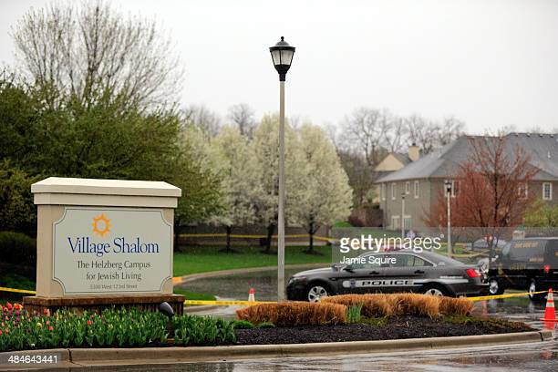 Police cars sit outside Village Shalom the senior living center where one of three victims was killed when a gunman opened fire on April 13 2014 in...