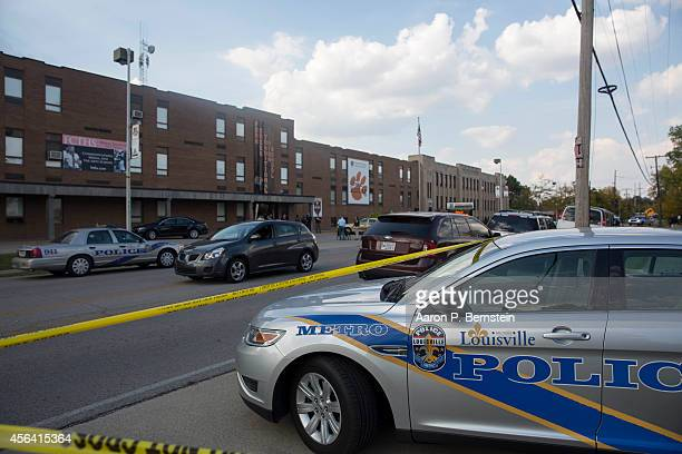 Police cars sit parked outside Fern Creek High School following a shooting incident September 30 2014 in Louisville Kentucky Police say a male...