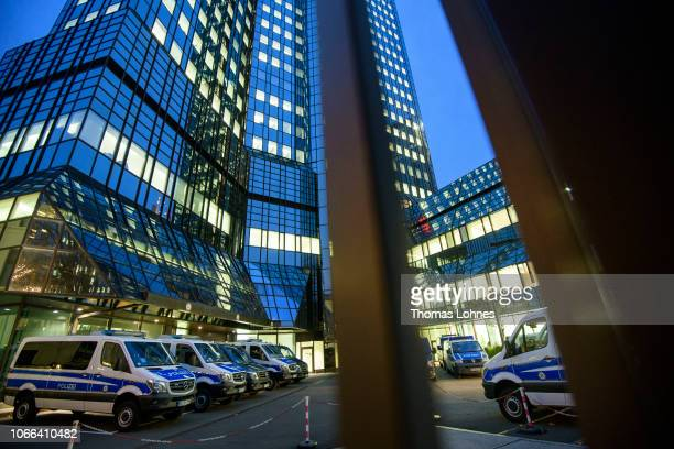 Police cars stand at the corporate headquarters of Deutsche Bank on November 29 2018 in Frankfurt Germany German law enforcement and tax authorities...