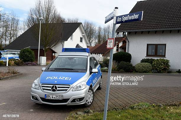 Police cars stand in a small street on March 26 in Montabaur soutwestern Germany from where the copilot of the crashed Germanwings plane came...