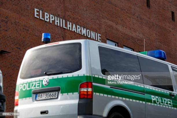 Police cars stand in front of the Elbphilharmonie concert hall on June 21 2017 in Hamburg Germany Hamburg will host the upcoming G20 summit from July...