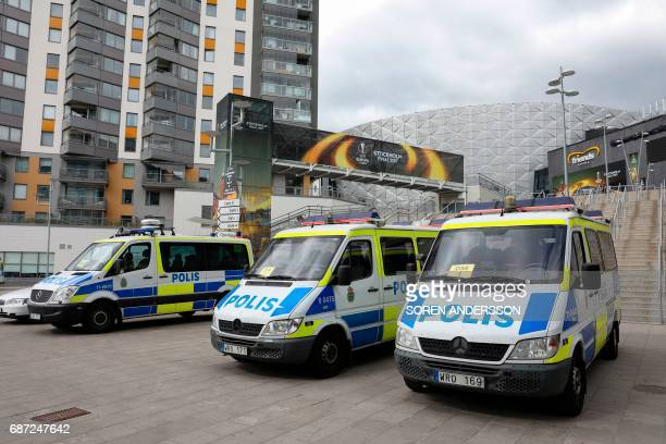 Police cars stand in front of the Friends Arena in Solna outside Stockholm on May 23 on the eve of the UEFA Europa League football final between Ajax...
