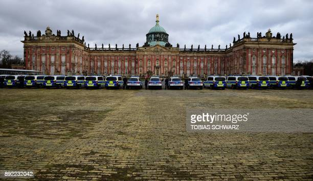 TOPSHOT Police cars stand in front of the New Palace during the handover of 50 new vehicles and equipment to the federal police on December 14 2017...