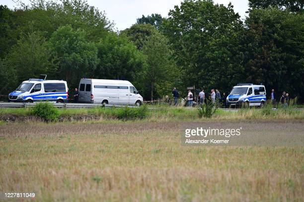 Police cars stand in line during a search at an allotment garden on July 28, 2020 in Hanover, Germany. German Investigators are searching an...