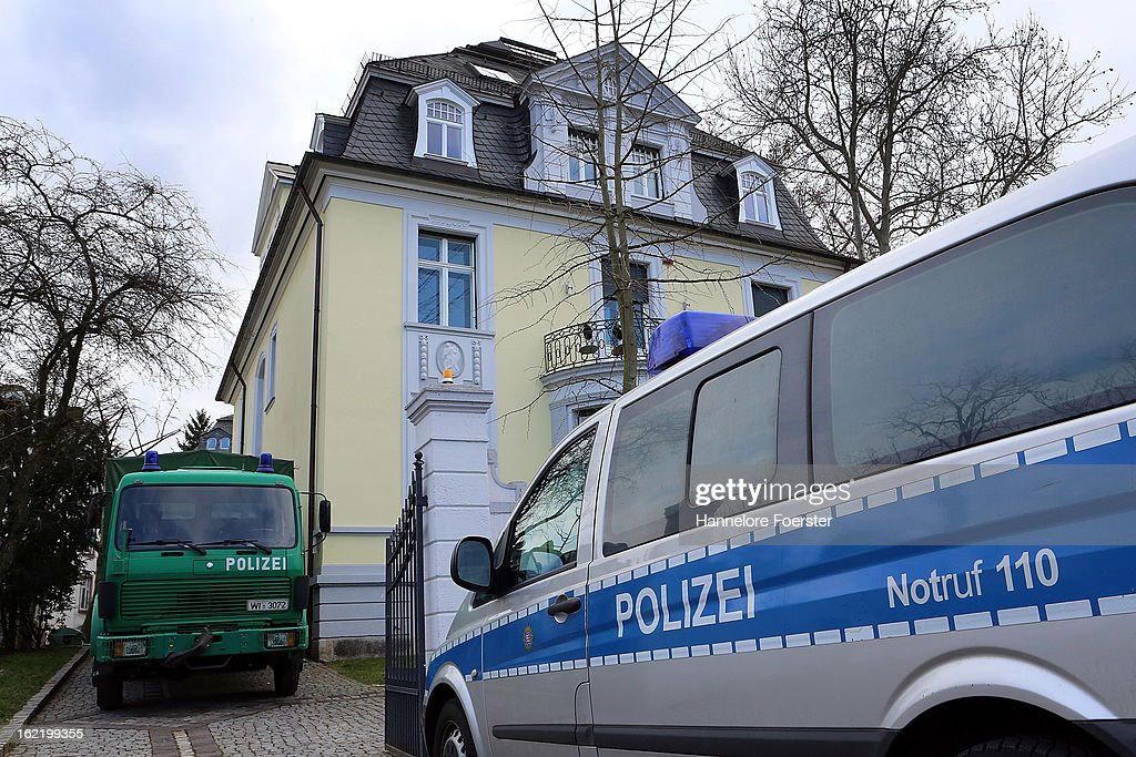 Police cars stand outside the headquarters of the S&K investment group the day after police raided the company's offices on February 20, 2013 in Frankfurt, Germany. Police made six arrests across Germany and state prosecutors are charging that the company has swindled investors out of investments totaling over one hundred million Euros. At least one of the company's founders, Jonas Koeller and Stephan Schaefer, was among those arrested yesterday.