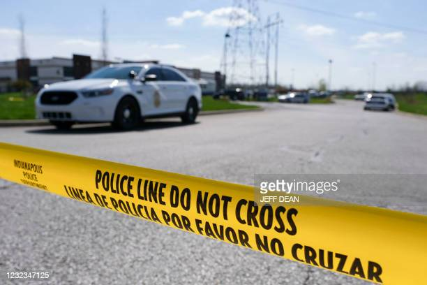 Police caution tape blocks the entrance to the site of a mass shooting at a FedEx facility in Indianapolis, Indiana on Friday, April 16, 2021. - A...