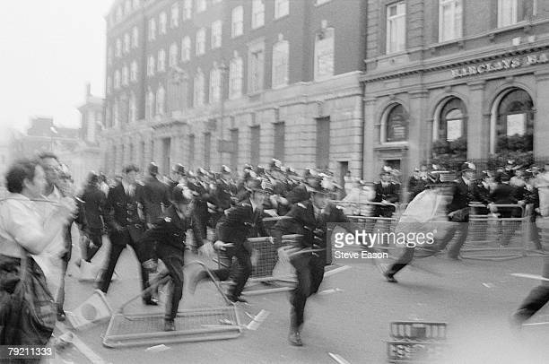 Police charge after rioting broke out at a demonstration against the Poll Tax London 31st March 1990