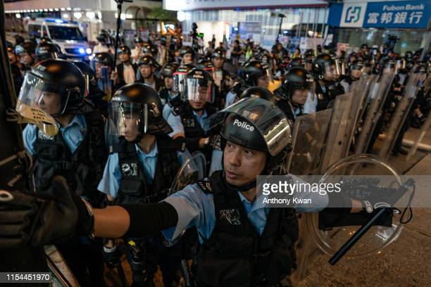 Police charge protesters in the Mong Kok district after attending a rally at West Kowloon railway station protesting against the proposed extradition...