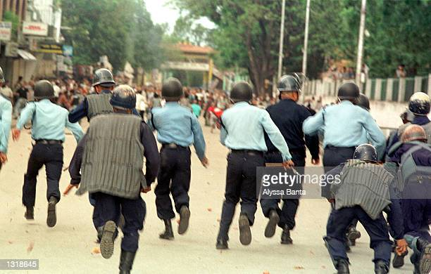 Police charge protesters June 4 2001 in Katmandu Nepal King Gyanendra the brother of slain King Birendra was sworn in after Crown Prince Dipendra...