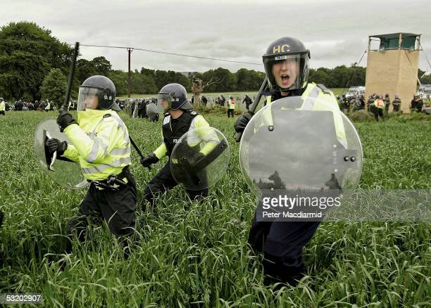 Police charge protestors in fields surrounding the G8 summit on July 6, 2005 near Gleneagles. The G8 summit where delegations from UK, US, Canada,...