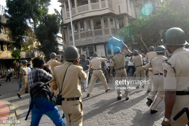 Police charging during protest in Bombay, Mumbai, Maharashtra, India