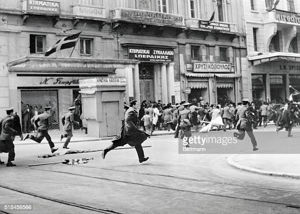 Police chase a crowd of demonstrators through the streets of Athens March 25th following a Greek Independence Day celebration that got out of hand...
