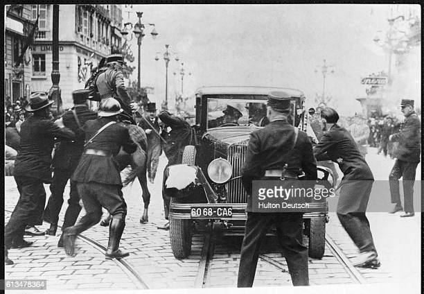Police chase after the assassin of King Alexander I of Yugoslavia during a state visit to Marseille