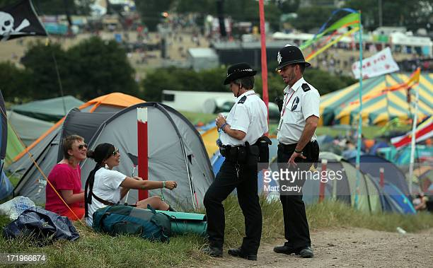 Police chat with campers at the Glastonbury Festival of Contemporary Performing Arts site at Worthy Farm Pilton on June 30 2013 near Glastonbury...