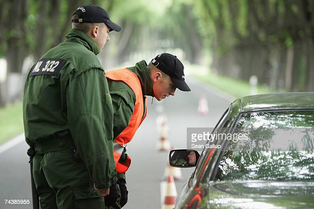 Police check a car at a checkpoint along the road leading to the resort of Heiligendamm June 3 2007 near Bad Doberan Germany German authorities have...