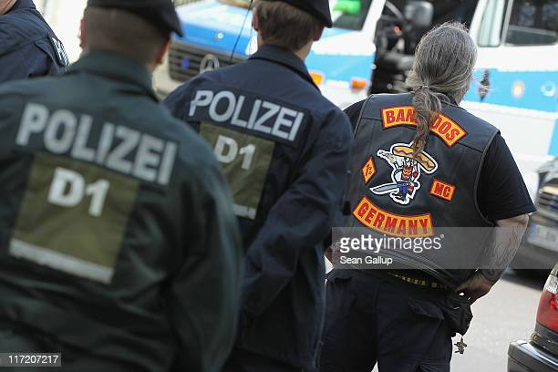 Police check a member of the Bandidos motorcycle gang near the Bandidos Berlin City club on June 24 2011 in Berlin Germany Both the Berlin City and...