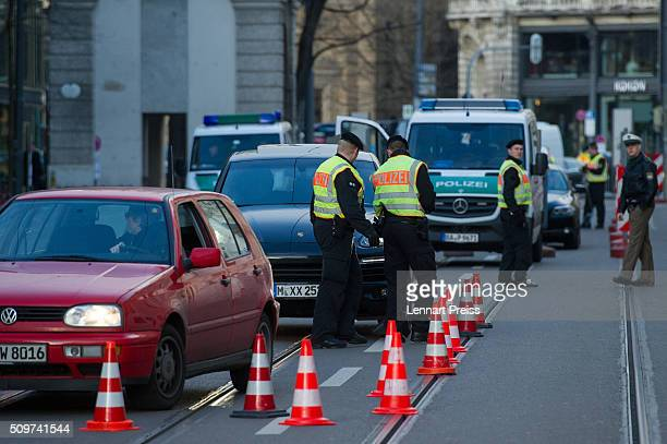 Police check cars entering the security zone around the hotel Bayerischer Hof ahead of the 2016 Munich Security Conference at the Bayerischer Hof...