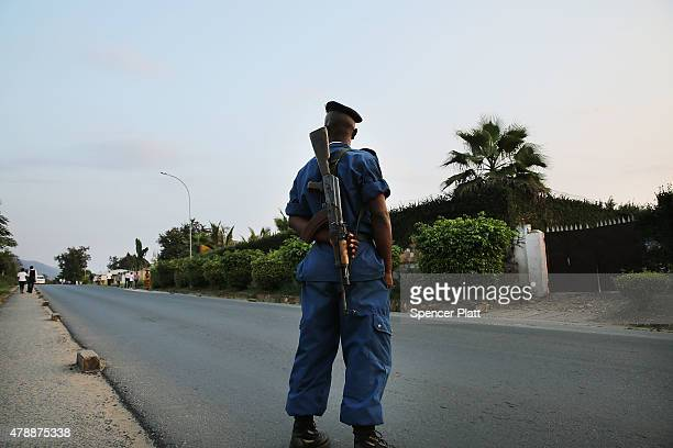 Police check cars for weapons on the outskirts of an opposition neighborhood on June 28, 2015 in Bujumbura, Burundi. The head of Burundi's...