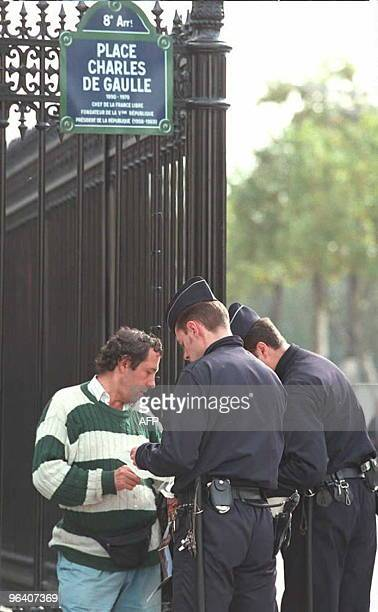 Police check identity papers on Place CharlesdeGaulle next to the Arc de Triomphe in Paris 18 October the day following the bomb expolosion on a...