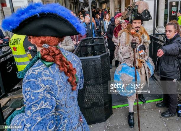 Police check revellers wearing masks and period costumes accessing Piazza San Marco during the Venice Carnival on March 03 2019 in Venice Italy The...