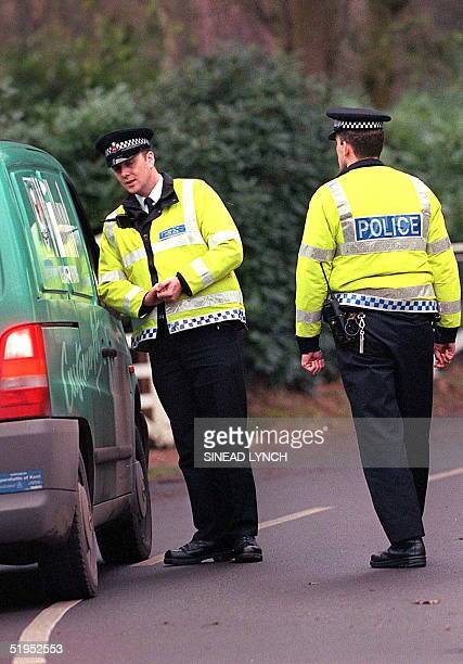Police check vehicles outside the Wentworth estate in Surrey where Augusto Pinochet resides in detainment 12 January 2000. British Home Secretary...