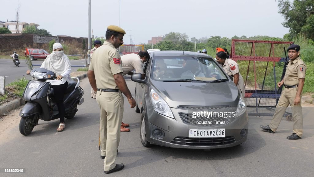 Police checking at Mohali and Chandigarh boarder on August 25 2017 in Chandigarh India The godman Gurmeet Ram Raheem Chief of Dera Sacha Sauda was...