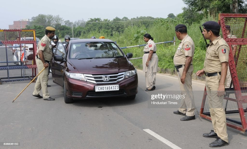 Police checking at Mohali and Chandigarh border on August 25 2017 in Chandigarh India The godman Gurmeet Ram Raheem Chief of Dera Sacha Sauda was...