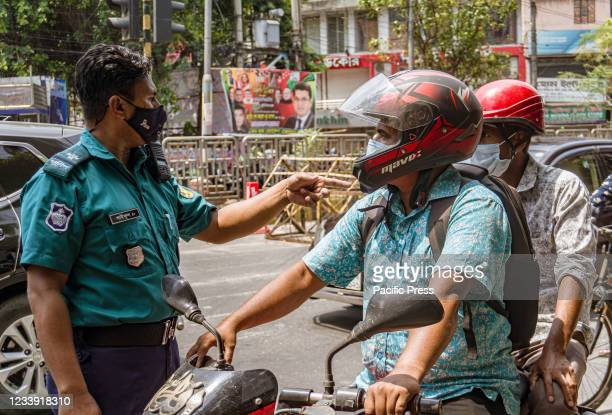 Police checking for passengers' Movement Passes issued by Dhaka Metropolitan Police. Bangladesh goes on a 14 days complete shutdown due to the...