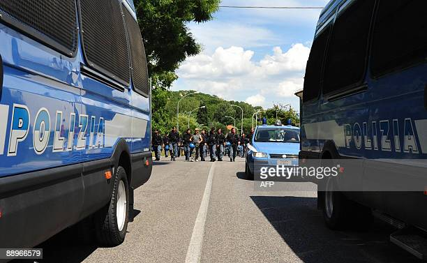 A Police checkpoint is pictured as protestors demonstrate in the quakehit Italian town of L'Aquila where a G8 summit is taking place on July 10 2009...